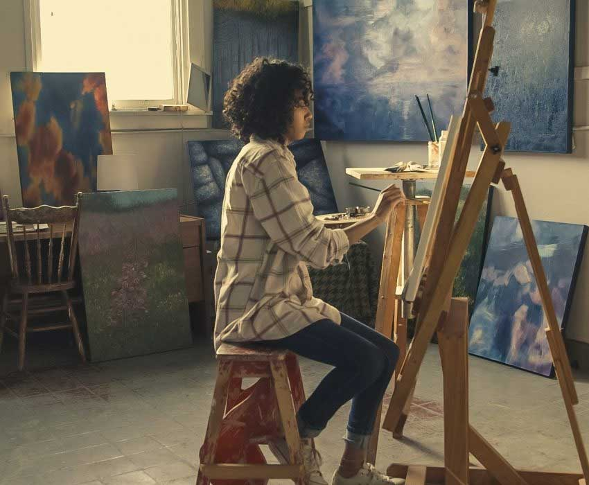 Woman Painting - Copyrights | Loeffler IP Group - Southwest Florida Intellectual Property Lawyers